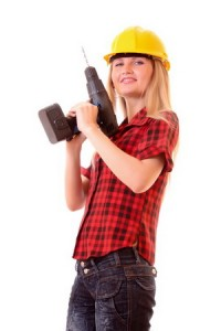 Дівчина будівельник з дрелью